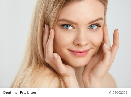 Woman Face Care. Young Female With Hands Touching Beauty Skin
